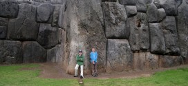 Kids in Front of Giant Stone in Peru
